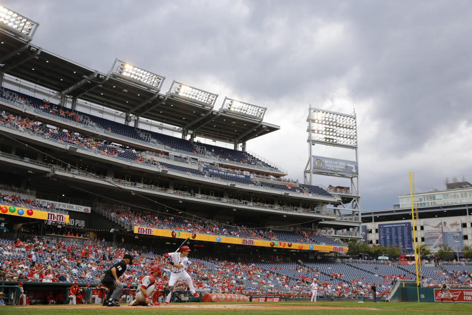 Washington Nationals' Trea Turner stands in the batter's box in front of Philadelphia Phillies catcher Andrew Knapp and umpire Vic Carapazza in the first inning of a baseball game, Thursday, Sept. 26, 2019, in Washington. (AP Photo/Patrick Semansky)