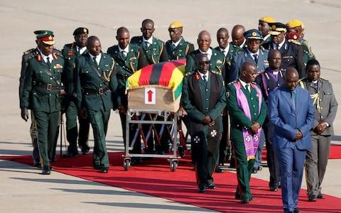 Mugabe's body will do a tour of the country before it is buried - Credit: REUTERS/Siphiwe Sibeko