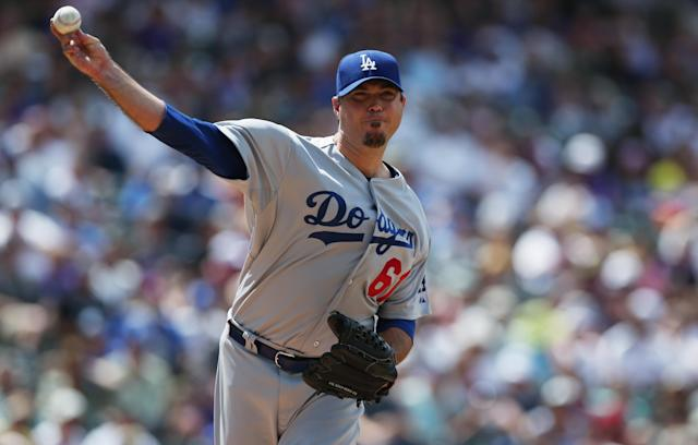 Los Angeles Dodgers starting pitcher Josh Beckett turns to make pickoff throw against the Colorado Rockies in the third inning of a baseball game in Denver on Sunday, July 6, 2014. (AP Photo/David Zalubowski)