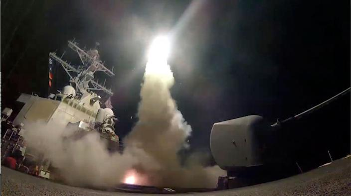 <p>The guided-missile destroyer Porter fires a missile toward a Syrian base from a posiition in the Mediterranean Sea, April 7, 2017. (U.S. Navy via AP) </p>