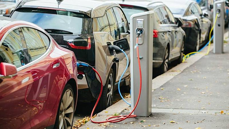 ev cars charging on the street