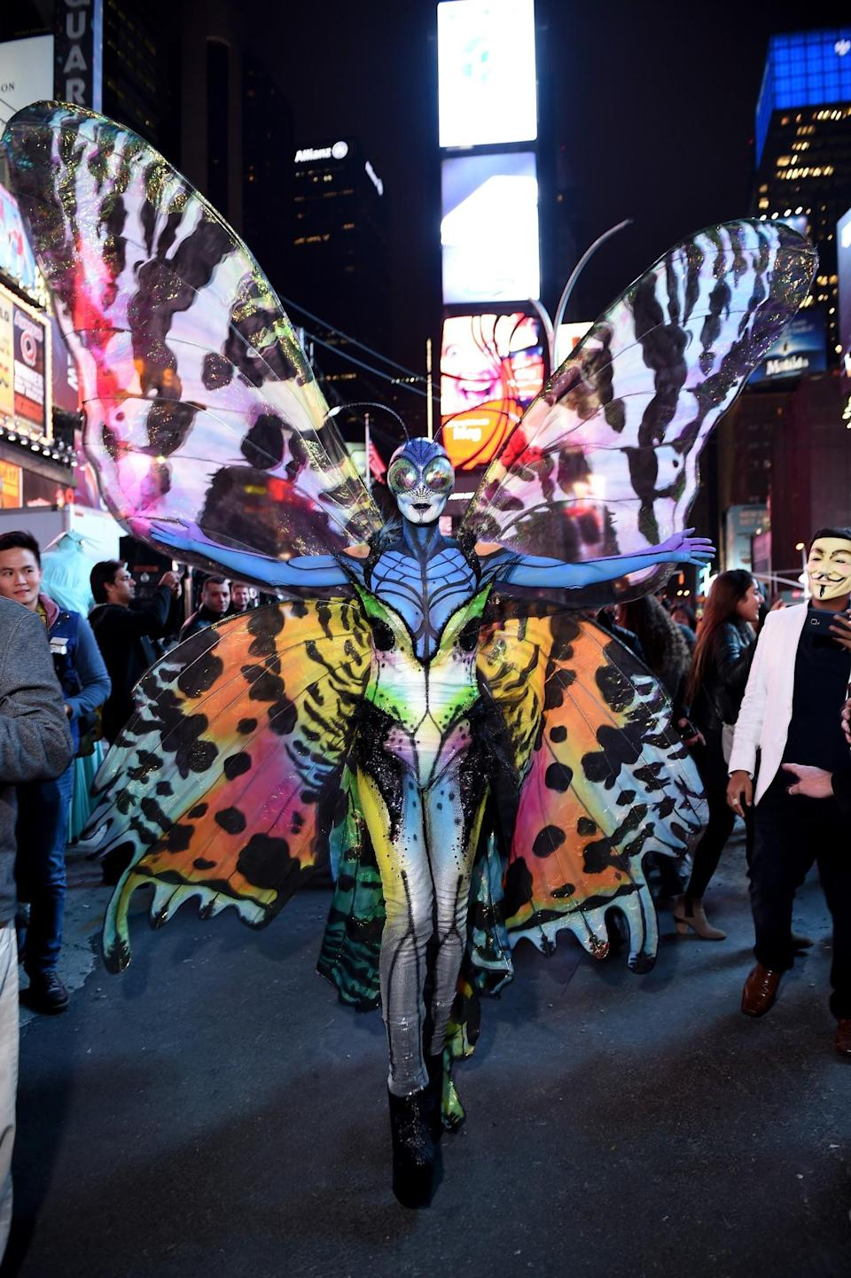 <p>In 2014, Klum arrived as a bug-eyed butterfly, antennae and all. (Photo: Getty Images) </p>