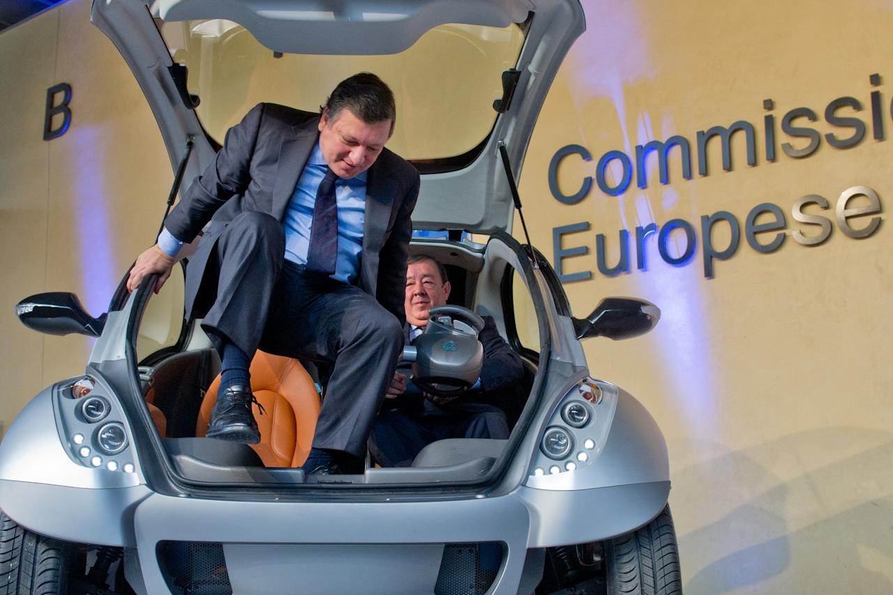 "BRUSSELS, BELGIUM - JANUARY 24:  EU Commission President Jose Manuel Barroso and Jesus Echave, chairman of the HIRIKO-AFYPAIDA corporate consortiumk, try out the first prototype of the HIRIKO electric car, during the global launch of Hiriko Driving Mobility at the EU Commssion headquarters on January 24, 2012 in Brussels, Belgium. The electronic eco-friendly vehicle will be manufactured in deprived areas of cities who take up Hiriko's ""social purpose"" model. Malmo in Sweden has already signed up to trial Hiriko with Berlin, Barcelona, Vitoria-Gasteiz (the second largest Basque city), San Francisco, and Hong Kong expected to follow suit.  (Photo by Geert Vanden Wijngaert/Getty Images)"