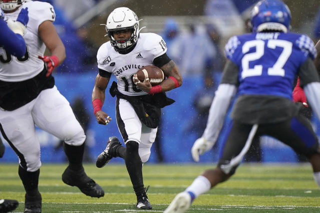 Louisville running back Javian Hawkins (10) runs the ball during the first half of the NCAA college football game against Kentucky, Saturday, Nov. 30, 2019, in Lexington, Ky. (AP Photo/Bryan Woolston)