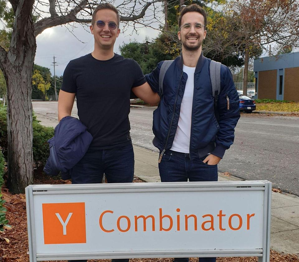 Wasp founders Martin and Matija Sosic standing behind Y Combinator sign