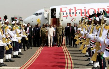 FILE PHOTO: Ethiopian Prime Minister Abiy Ahmed arrives at the airport in Khartoum