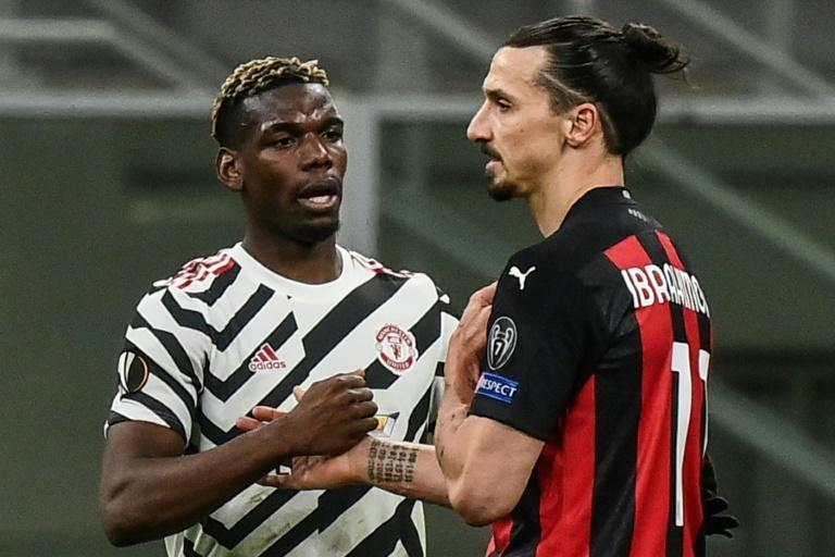 Man United's Paul Pogba (L) exchanges jersey with AC Milan forward Zlatan Ibrahimovic.