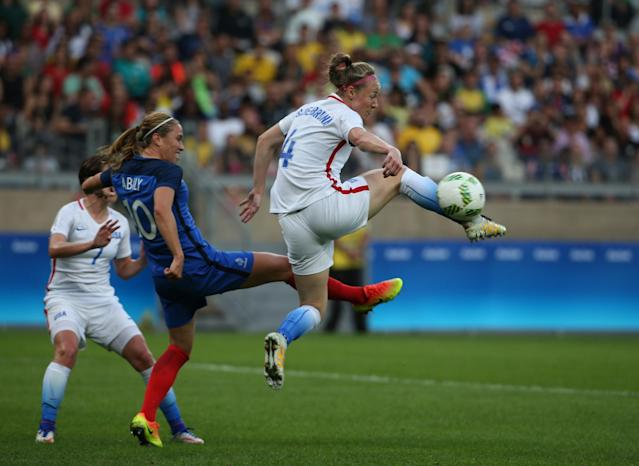 <p>United States' Becky Sauerbrunn, right, fights for the ball with France's Camille Abily during a group G match of the women's Olympic football tournament between United States and France at the Mineirao stadium in Belo Horizonte, Brazil, Saturday, Aug. 6, 2016. (AP Photo/Eugenio Savio) </p>