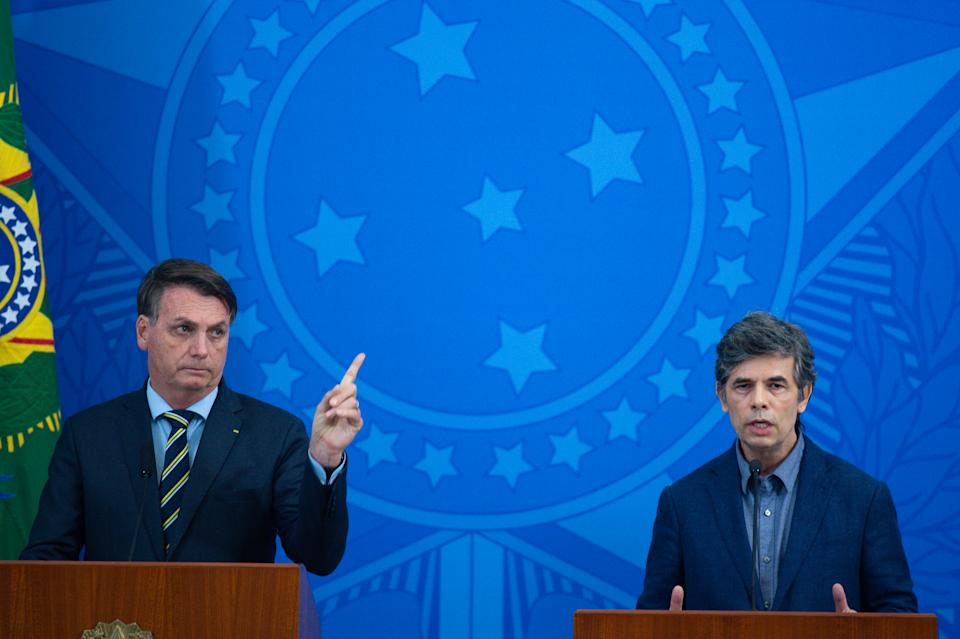BRASILIA, BRAZIL - APRIL 16: (L-R)President of Brazil Jair Bolsonaro and Health Minister Nelson Teich speak during a press conference to announce Teich as newly appointed Health Minister amidst coronavirus (COVID-19) pandemic at the Planalto Palace on April, 16, 2020 in Brasilia. President Bolsonaro has fired outgoing Minister of Health Luiz Henrique Mandetta over differences in coronavirus strategy. Brazil has over 30,000 confirmed positive cases of Coronavirus and 1942 deaths. (Photo by Andressa Anholete/Getty Images)