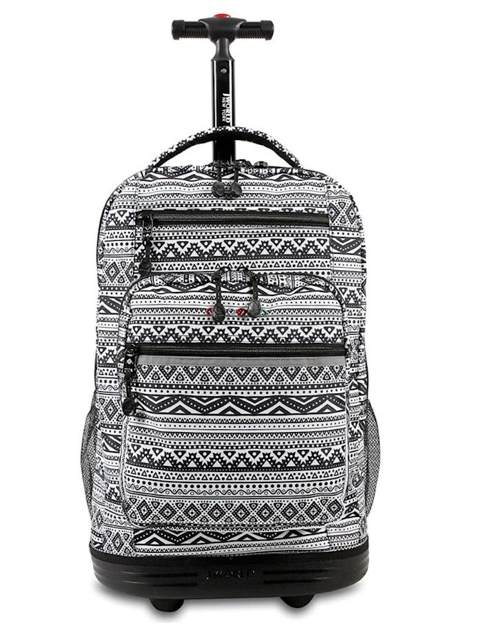 """Find this <a href=""""https://amzn.to/2WY76t1"""" rel=""""nofollow noopener"""" target=""""_blank"""" data-ylk=""""slk:J World laptop rolling backpack"""" class=""""link rapid-noclick-resp"""">J World laptop rolling backpack</a> for $48 on <a href=""""https://amzn.to/2WY76t1"""" rel=""""nofollow noopener"""" target=""""_blank"""" data-ylk=""""slk:Amazon"""" class=""""link rapid-noclick-resp"""">Amazon</a>."""