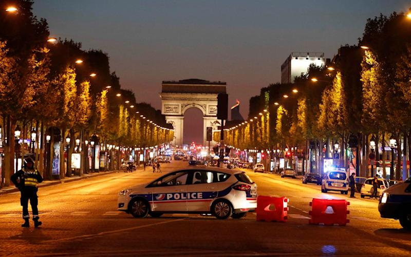 Police secure the Champs Elysee Avenue  - Credit: Reuters