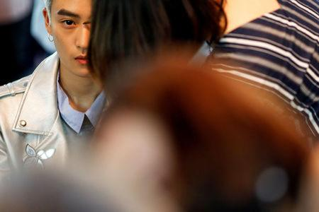 "FILE PHOTO:  A member of China's all-girl ""boyband"" FFC-Acrush is prepared for the band's maiden press conference in Beijing"
