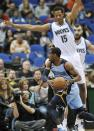 Minnesota Timberwolves' Anthony Randolph (15) defends Memphis Grizzlies' Mike Conley during the first half of an NBA basketball game Tuesday, April 17, 2012, in Minneapolis. (AP Photo/Jim Mone)