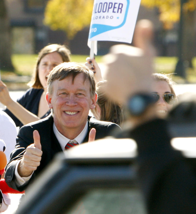 Colorado Democratic gubernatorial candidate John Hickenlooper gives a passing motorist a double thumbs-up as he and supporters do a honk and wave  in Denver,  Tuesday, Nov. 2, 2010. (AP Photo/ Ed Andrieski)