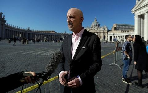 Peter Isely, founding member of Ending Clergy Abuse, in St. Peter's Square at the Vatican - Credit: Gregorio Borgia/AP