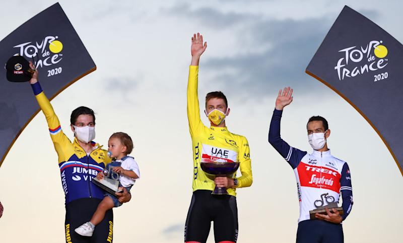 PARIS FRANCE SEPTEMBER 20 Podium Primoz Roglic of Slovenia and Team Jumbo Visma with his son Levom Tadej Pogacar of Slovenia and UAE Team Emirates Yellow Leader Jersey Richie Porte of Australia and Team Trek Segafredo Celebration Trophy Mask Covid safety measures during the 107th Tour de France 2020 Stage 21 a 122km stage from MantesLaJolie to Paris Champslyses TDF2020 LeTour on September 20 2020 in Paris France Photo by Michael SteeleGetty Images
