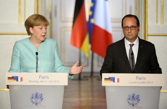"""German Chancellor Angela Merkel speaks during a joint press conference with French President Francois Hollande at the Elysee Palace in Paris on July 6, 2015, meeting to """"evaluate the consequences of the referendum in Greece"""" (AFP Photo/Bertrand Guay)"""