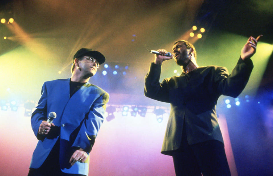 <p>George Michael performing live with Elton John in the early 1990s. (Photo: Steve Rapport/Photoshot/Getty Images) </p>