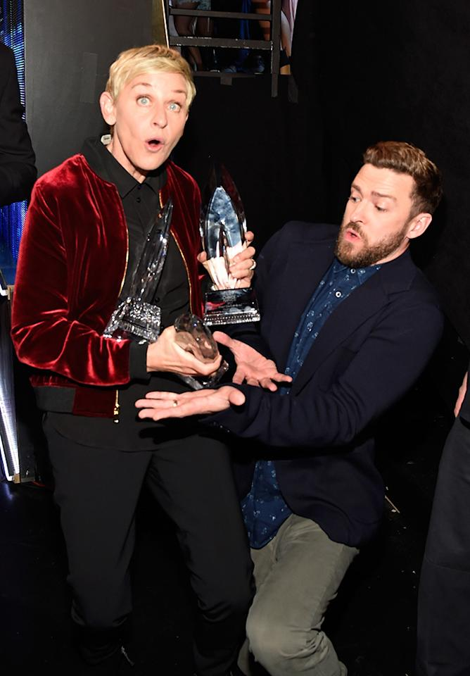 <p>Ellen DeGeneres became the winningest person in People's Choice Awards history at Wednesday's show in downtown L.A. Her good friend Justin Timberlake was there to present this year's haul — and to help her avoid dropping any of the trophies backstage. (Photo: Kevin Mazur/WireImage) </p>