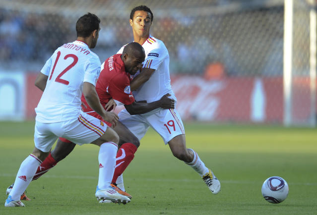 Innocent Emeghara of Switzerland (center) vies with Martin Montoya (L) and Thiago Alcantara of Spain during the UEFA Under-21 European Championship final football match at NRGI Park Stadium in Arhus Stadion Denmark on June 25, 2011. AFP PHOTO CLAUS FISKER/SCANPIX (Photo credit should read CLAUS FISKER/AFP/Getty Images)