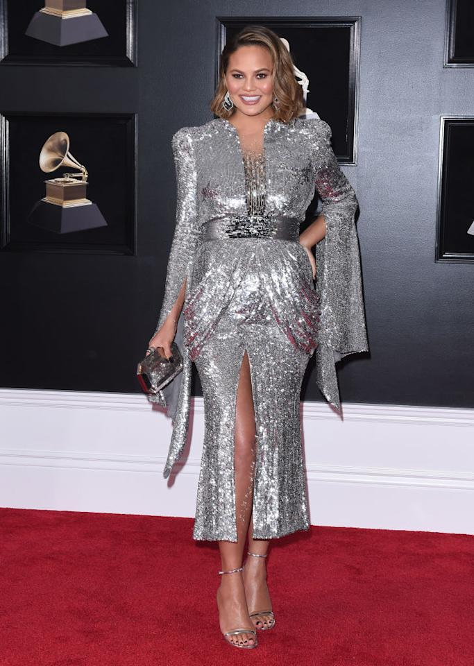<p>You thought maternity dressing was predictable? Think again. Chrissy Teigen donned a show-stopping silver look by Yanina Couture. And how better to accessorise the look with yet more sparkle? <em>[Photo: Getty]</em> </p>