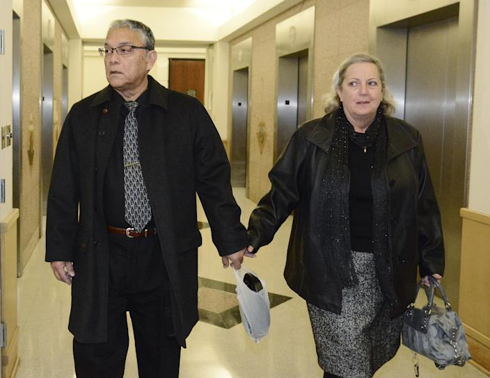 Ernest and Lynne Machado, parents of Marlise Munoz, walk to the 96th District Court Friday, Jan. 24, 2014 in Fort Worth, Texas. A judge has ordered a Texas hospital to remove life support for a pregnant, brain-dead woman. Judge R. H. Wallace Jr. issued the ruling Friday in the case of Marlise Munoz. John Peter Smith Hospital in Fort Worth has been keeping Munoz on life support against her family's wishes. Munoz was 14 weeks pregnant when her husband found her unconscious Nov. 26, possibly due to a blood clot. (AP Photo/Tim Sharp)
