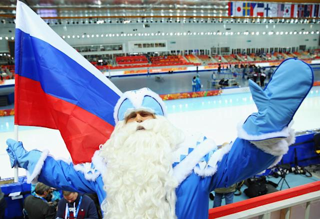 SOCHI, RUSSIA - FEBRUARY 08: A fan enjoys the atmosphere ahead of the Men's 5000m Speed Skating event during day 1 of the Sochi 2014 Winter Olympics at Adler Arena Skating Center on February 8, 2014 in Sochi, Russia. (Photo by Quinn Rooney/Getty Images)