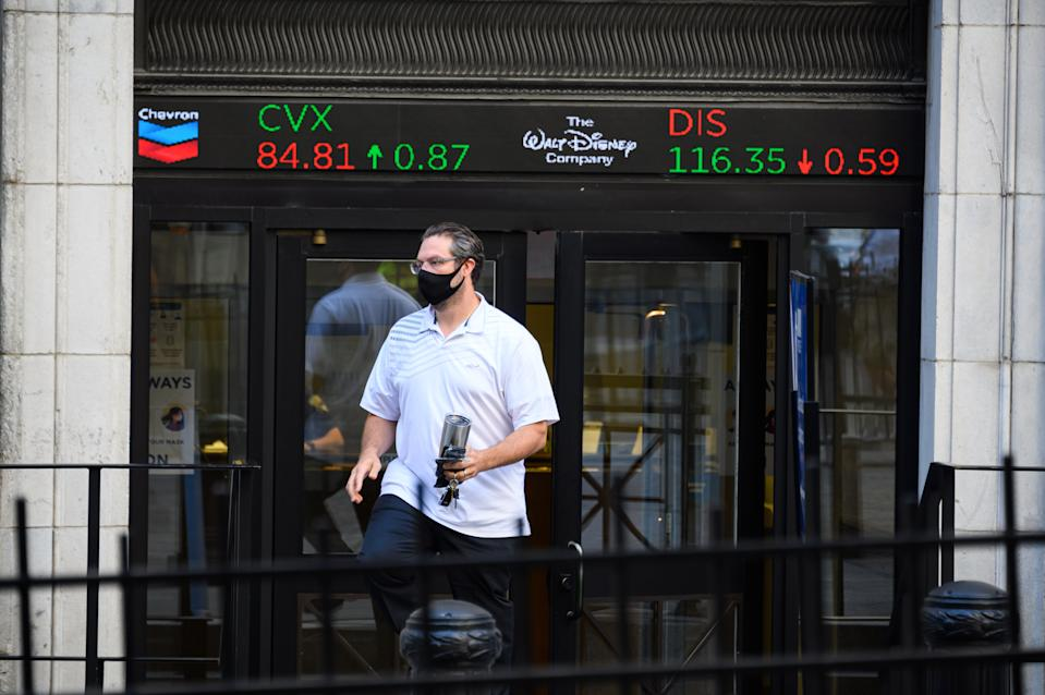 NEW YORK, NEW YORK - AUGUST 03: A person walks out of the New York Stock Exchange as the city continues Phase 4 of re-opening following restrictions imposed to slow the spread of coronavirus on August 3, 2020 in New York City. The fourth phase allows outdoor arts and entertainment, sporting events without fans and media production. (Photo by Noam Galai/Getty Images)