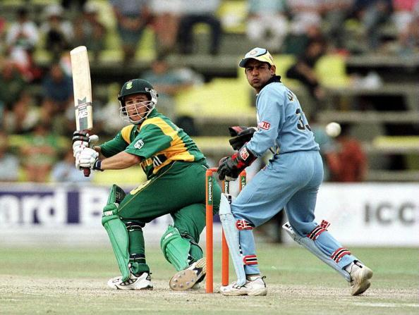 13 Oct 2000:  Mark Boucher of South Africa hits out watched by V. Dahiya of India during the India v South Africa Semi-Final of the ICC Knockout Tournament at the Gymkhana Ground, Nairobi, Kenya Mandatory Credit: Tom Shaw/ALLSPORT