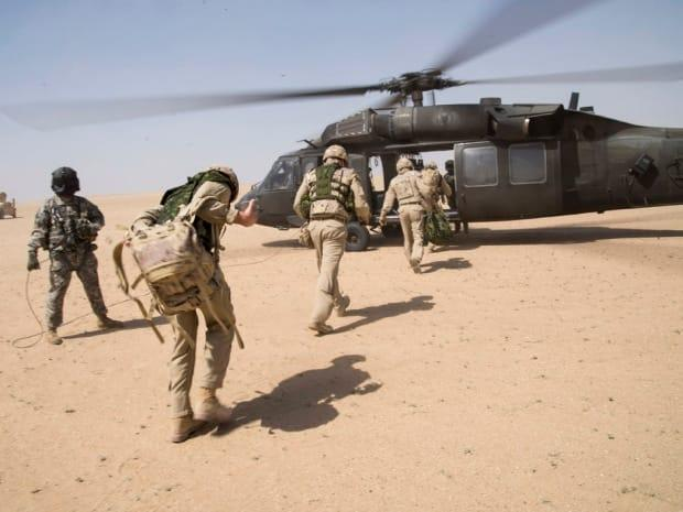 Royal Canadian Air Force members of Air Task Force-Iraq and several members of the coalition participate in the SHAMAL SERIALS, a combat search and rescue exercise held for personnel of the Middle East Stabilization Force, in a training area in Kuwait on March 16, 2015.