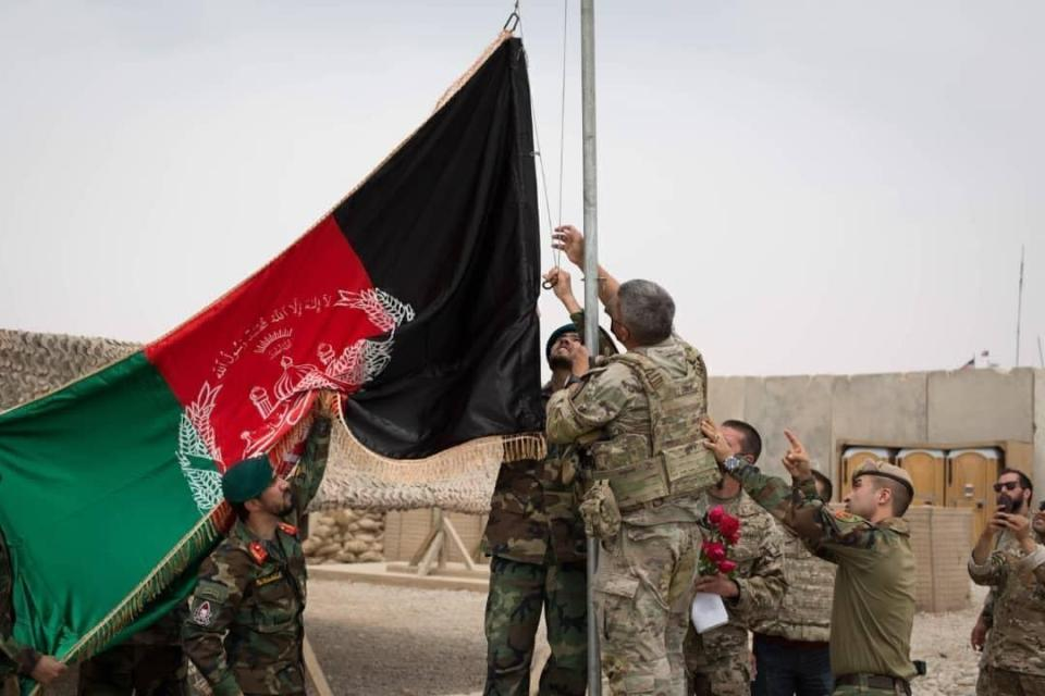 FILE - An Afghan flag is raised during a handover ceremony from the U.S. Army to the Afghan National Army, at Camp Anthonic, in Helmand province, southern Afghanistan, Sunday, May 2, 2021. The former Soviet Union marched into Afghanistan on Christmas Eve, 1979, claiming it was invited by the new Afghan communist leader, Babrak Karmal, setting the country on a path of 40 years of seemingly endless wars and conflict. After the Soviets left in humiliation, America was the next great power to wade in. (Afghan Ministry of Defense Press Office via AP, File)
