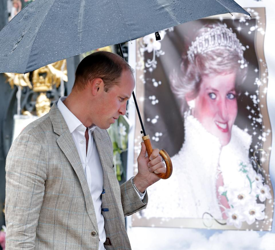 LONDON, UNITED KINGDOM - AUGUST 30: (EMBARGOED FOR PUBLICATION IN UK NEWSPAPERS UNTIL 48 HOURS AFTER CREATE DATE AND TIME) Prince William, Duke of Cambridge views tributes to Diana, Princess of Wales left at the gates of Kensington Palace after visiting the Sunken Garden on August 30, 2017 in London, England. The Sunken Garden has been transformed into a White Garden dedicated to Diana, Princess of Wales mother of The Duke of Cambridge and Prince Harry marking the 20th anniversary of her death. (Photo by Max Mumby/Indigo/Getty Images)