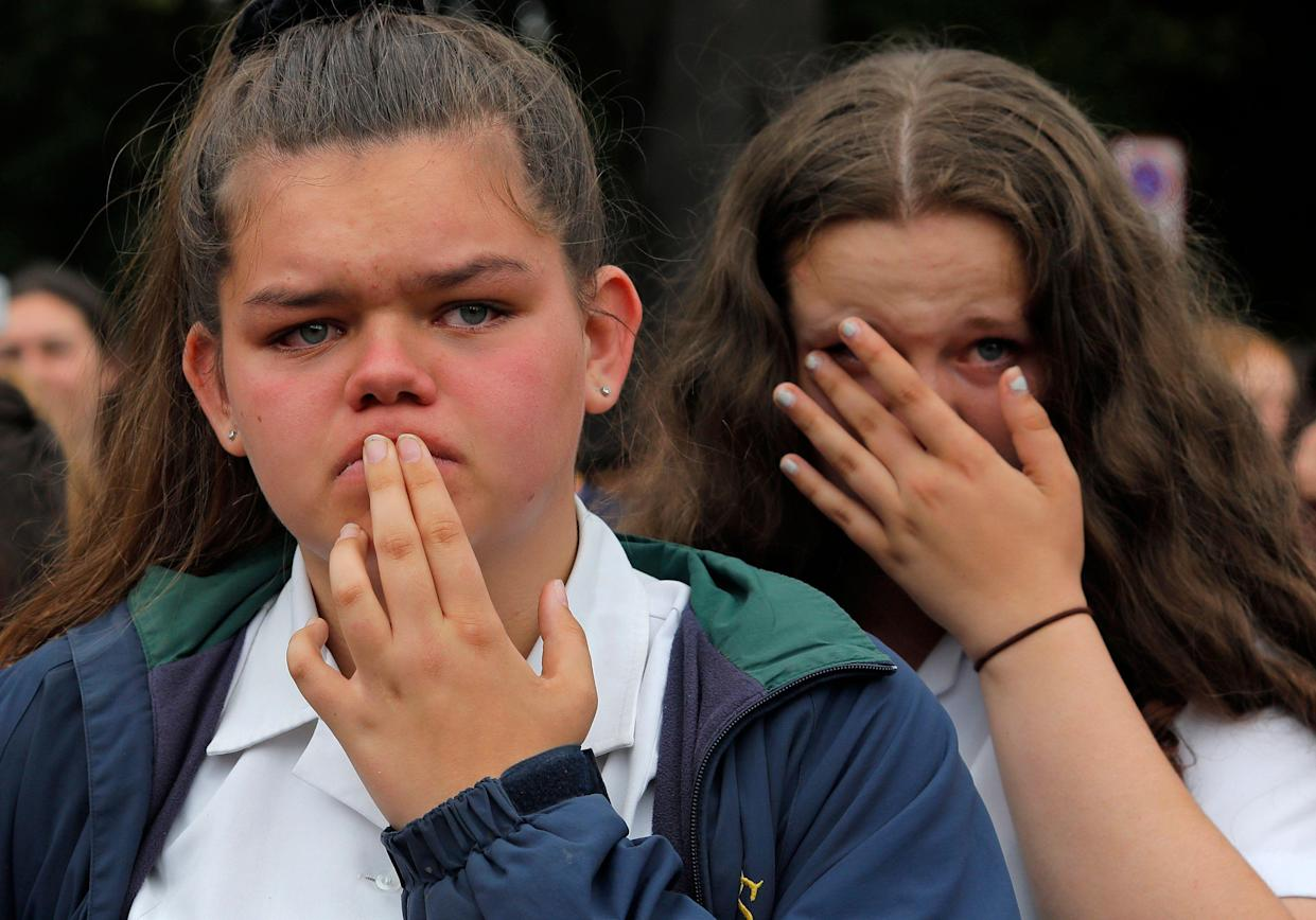 Students react as they gather for a vigil to commemorate victims of Friday's shooting, outside the Al Noor mosque in Christchurch, New Zealand, Monday, March 18, 2019. (Photo: Vincent Yu/AP)