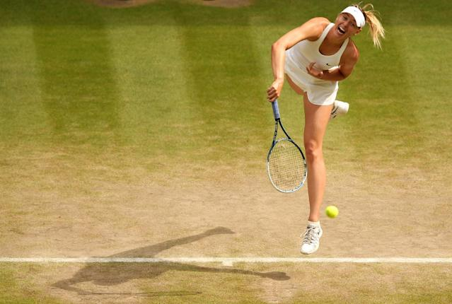 Russia's Maria Sharapova returns to Germany's Angelique Kerber during their women's singles fourth round match on day eight of the 2014 Wimbledon Championships at The All England Tennis Club in Wimbledon, southwest London, on July 1, 2014 (AFP Photo/Andrew Yates)