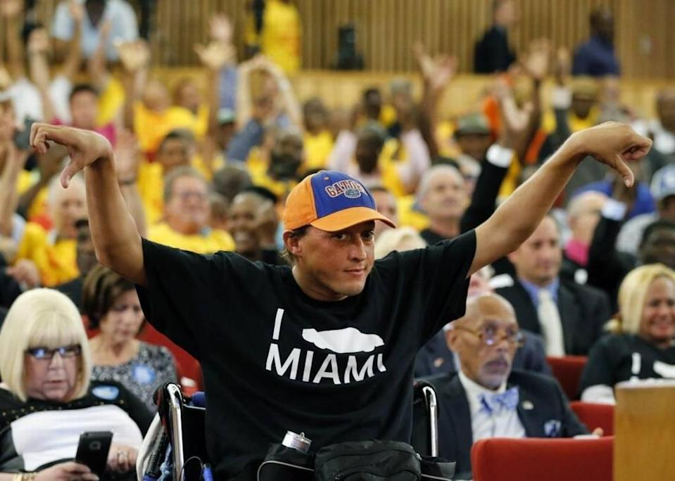 Chaunce O'Connor holds thumbs down for comments made against Uber support as the public speaks during a final vote in the Miami-Dade commission for legislation that would legalize Uber, Lyft and other ride-hailing services in the county on Tuesday, May 3, 2016.