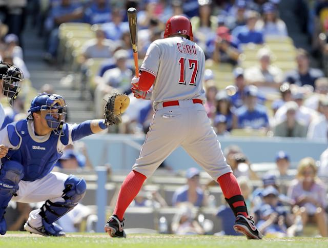 Cincinnati Reds' Shin-Soo Choo (17), of South Korea, is hit by a pitch from Los Angeles Dodgers pitcher Ronald Belisario in the eighth inning of a baseball game in Los Angeles, Sunday, July 28, 2013. (AP Photo/Reed Saxon)