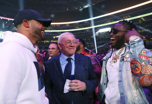 Dallas Cowboys defensive end DeMarcus Lawrence, right, said he is indifferent to team owner Jerry Jones' silence in the wake of George Floyd's death that sparked protests and social unrest around the country. (AP Photo/Richard W. Rodriguez)