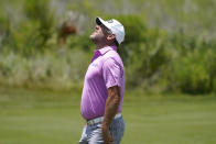 Lee Westwood, of England, reacts after a miss on the fourth green during the third round at the PGA Championship golf tournament on the Ocean Course, Saturday, May 22, 2021, in Kiawah Island, S.C. (AP Photo/Matt York)