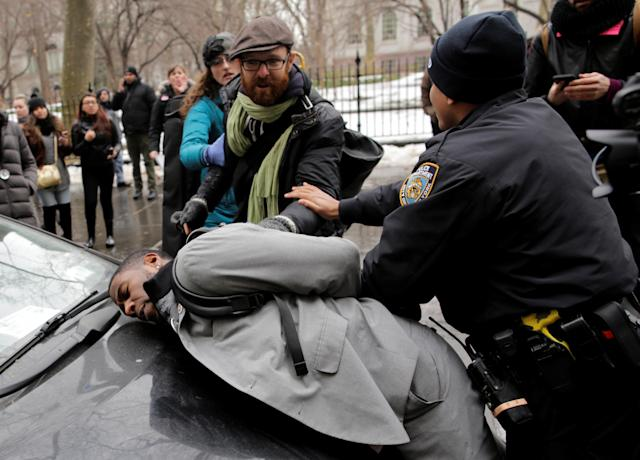 <p>New York City Council member Jumaane D. Williams is detained by police during a demonstration by activists against deportation outside the Jacob Javits Federal Building in Manhattan in New York City, Jan. 11, 2018. (Photo: Eduardo Munoz/Reuters) </p>