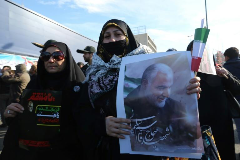 A Iranian woman carries a portrait of slain Iranian General Qasem Soleimani, on the 40th day of his killing in a US drone strike, during commemorations marking 41 years since the Islamic Revolution, on February 11 (AFP Photo/ATTA KENARE)