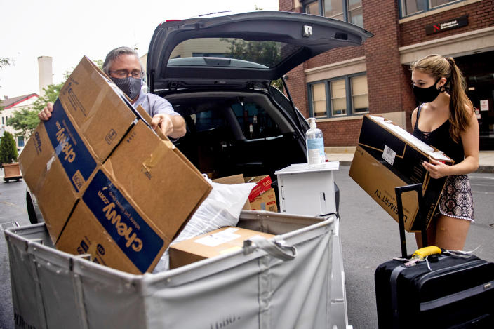 Gerald Cotten helps his daughter Briana Cotten, who is an RA and studies biology, load a moving bin to move into East Village on the campus of Northeastern on Aug. 19, 2020. (Matthew Modoono / Northeaster University)