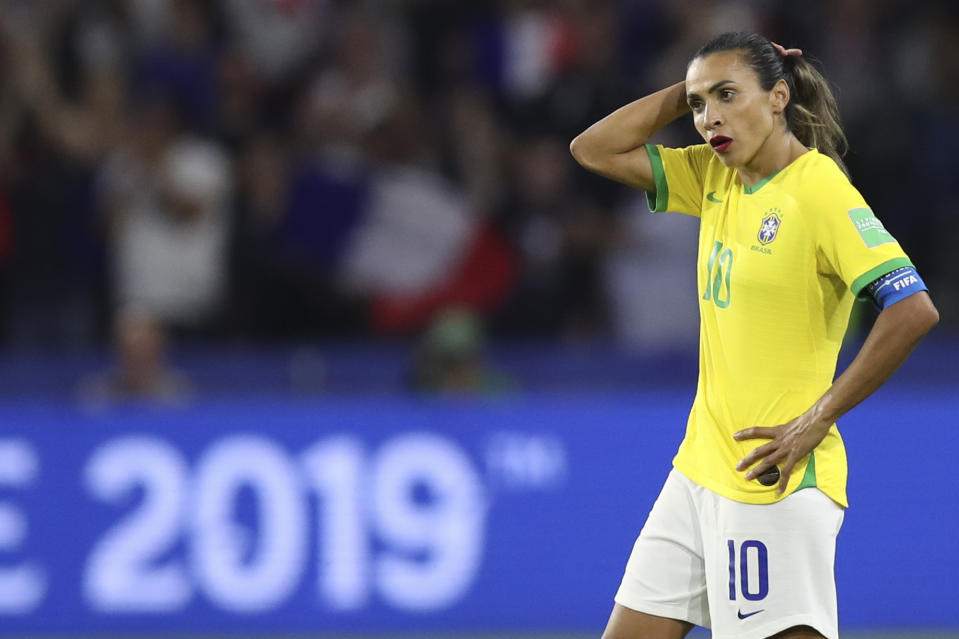 Brazil's Marta stands on the pitch at the end of the Women's World Cup round of 16 soccer match between France and Brazil at the Oceane stadium in Le Havre, France, Sunday, June 23, 2019. France beat Brazil 2-1. (AP Photo/Francisco Seco)