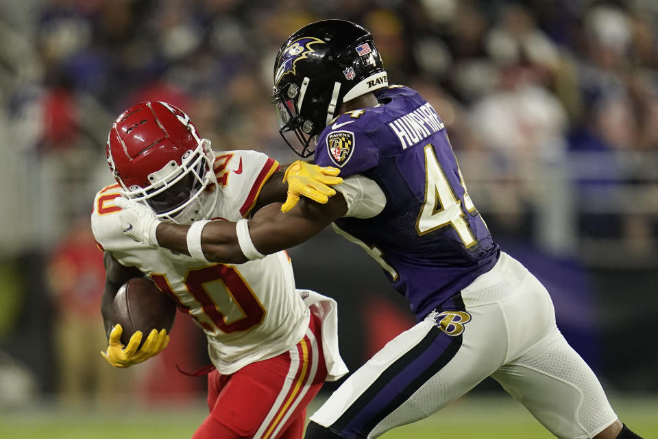 Kansas City Chiefs wide receiver Tyreek Hill, left, rushes against Baltimore Ravens cornerback Marlon Humphrey in the second half of an NFL football game, Sunday, Sept. 19, 2021, in Baltimore. (AP Photo/Julio Cortez)