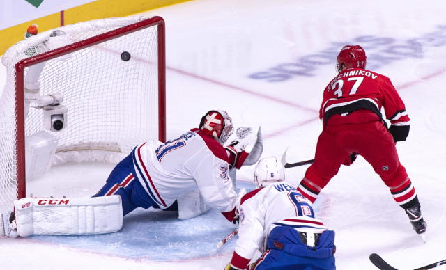 Carolina Hurricanes' Andrei Svechnikov scores past Montreal Canadiens goaltender Carey Price during the second period of an NHL hockey game, Thursday, Dec. 13, 2018 in Montreal. (Paul Chiasson/The Canadian Press via AP)