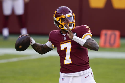 Washington Football Team quarterback Dwayne Haskins (7) passes the ball during the first half of an NFL football game against the Carolina Panthers, Sunday, Dec. 27, 2020, in Landover, Md. (AP Photo/Mark Tenally)