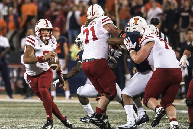 Nebraska quarterback Adrian Martinez (2) looks for an open receiver in the first half of an NCAA college football game against Illinois, Saturday, Sept. 21, 2019, in Champaign, Ill. (AP Photo/Holly Hart)