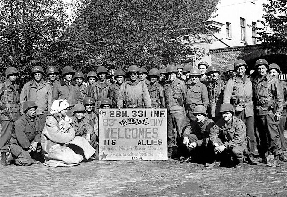 <p>Officers of the 83rd Infantry Division of the US Army welcoming Russia's Red Army in Hohenlepte, Germany. Soldier Tony Vaccaro snapped this photo, along with 7,000 others, during his time in the 83rd infantry.</p>
