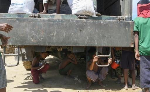 Rohingya plucked from river trying to swim to Bangladesh