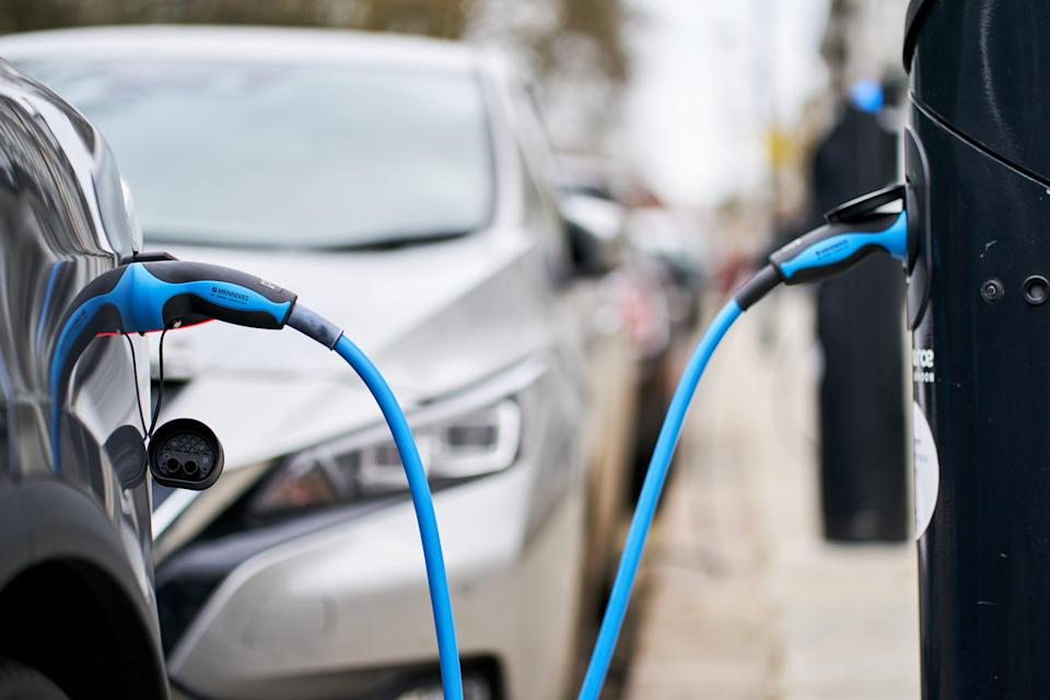 An electric car being charged (PA Wire)
