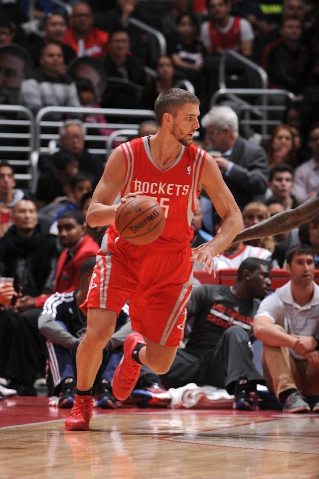 LOS ANGELES, CA - FEBRUARY 26: Chandler Parsons #25 of the Houston Rockets handles the ball against the Los Angeles Clippers at Staples Center on February 26, 2014 in Los Angeles, California. (Photo by Andrew D. Bernstein/NBAE via Getty Images)
